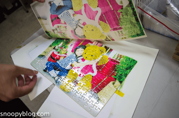 這張圖片的 alt 屬性值為空,它的檔案名稱為 customized-puzzle-printing-completed.png